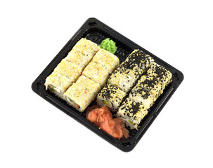 Sushi rolls in plastic container isolated on white closeup