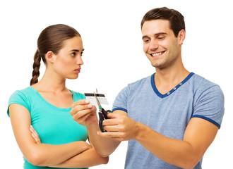 Angry Woman Looking At Man Cutting Credit Card