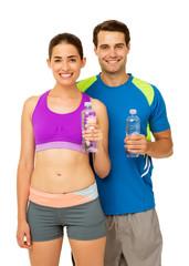 Happy Couple In Sports Wear Holding Water Bottles