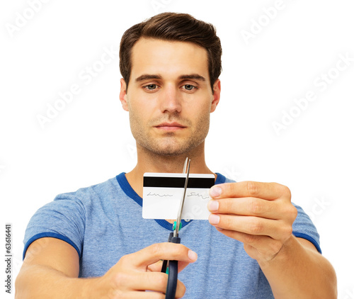 Serious Man Cutting Credit Card