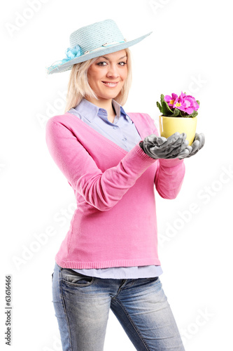 Young woman holding a flower
