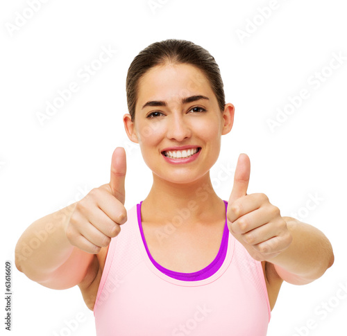 Happy Fit Woman Gesturing Thumbs Up
