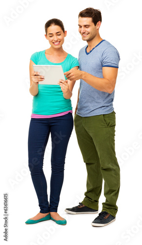Happy Young Couple Using Digital Tablet