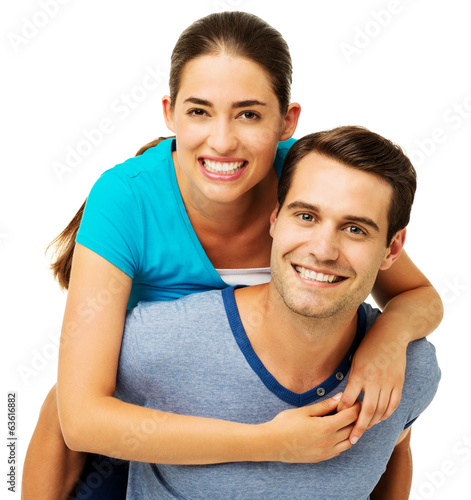 Happy Man Giving Piggyback Ride To Woman