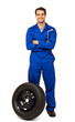 Happy Male Mechanic With Spare Tire