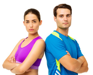 Couple In Sportswear Standing Arms Crossed