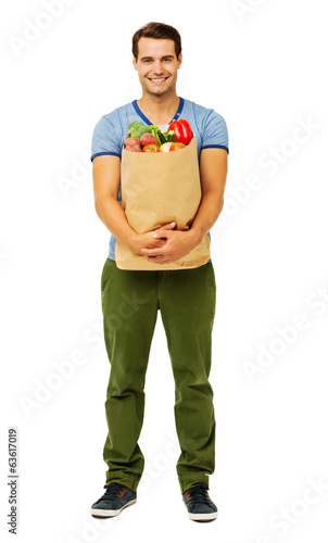 Young Man With Healthy Vegetables