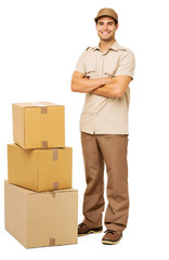 Deliveryman Standing By Stacked Cardboard Boxes