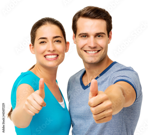 Couple Gesturing Thumbs Up Over White Background