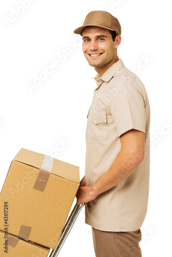 Smiling Young Deliveryman With Cardboard Boxes