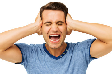 Furious Young Man Covering Ears With Hands