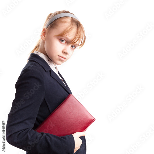 Portrait of blond Caucasian schoolgirl with red book isolated on