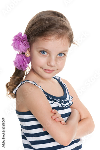 Confident little girl against the white background