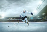 Ice hockey player on the ice. Open stadium - Winter Classic game