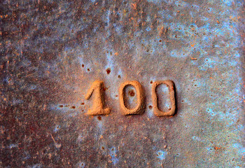 Detail of old railway track with number one hundred on it