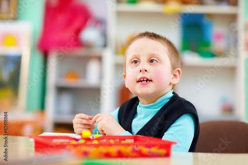Leinwanddruck Bild cognitive development of kids with disabilities