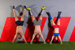 Handstand push-up group workout at gym