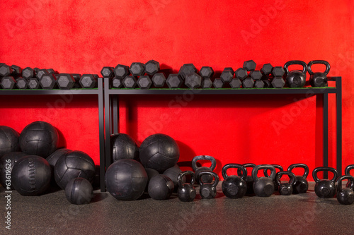Kettlebell  dumbbell and weighted balls at gym