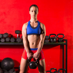 Kettlebell swing workout training woman at gym