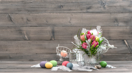 tulip flowers with easter eggs. vintage style