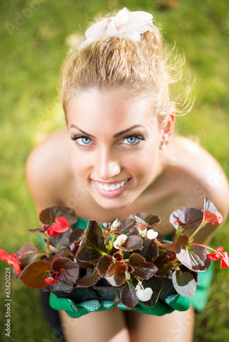 Beautiful woman planting flowers