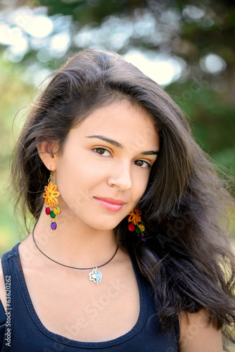 Portrait of beautiful teenage girl with handmade earrings