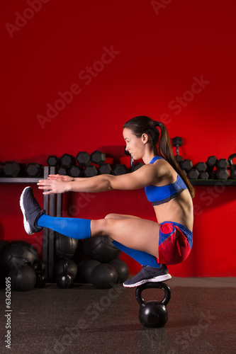 kettlebell woman pistol squat  balance at gym
