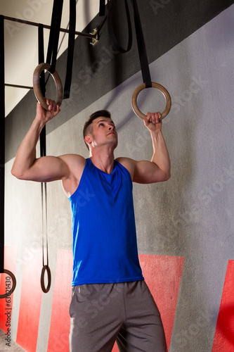 Rings workout man at gym hanging