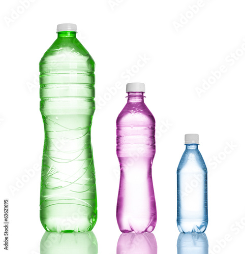 three plastic bottles isolated on white