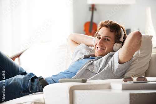 Guy with headphones on sofa