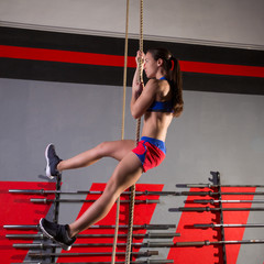Rope Climb exercise woman workout at gym