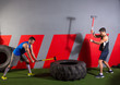 Sledgehammer Tire Hits men workout at gym