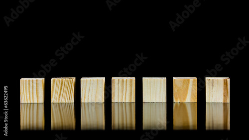 Seven blank wooden blocks