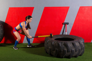 Sledgehammer Tire Hits woman workout at gym