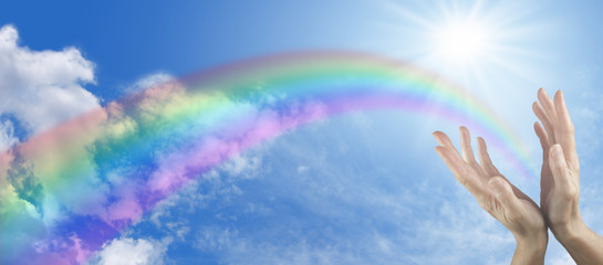 Hands, sun, blue sky and rainbow website banner