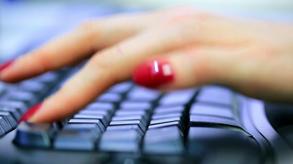 Young woman typing on keyboard.