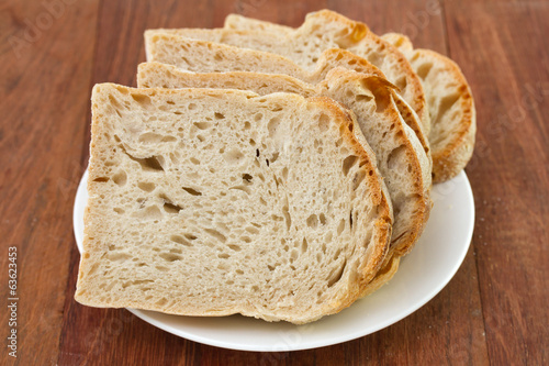 bread on plate on brown background