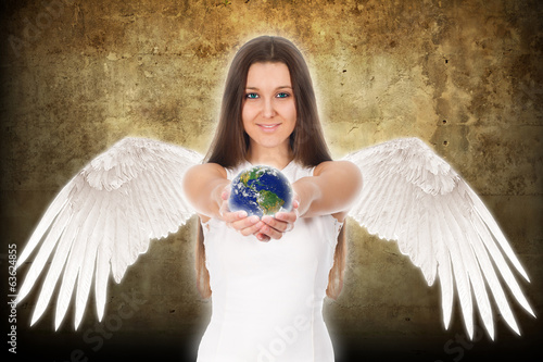 beautiful young angel woman holding Earth in hands