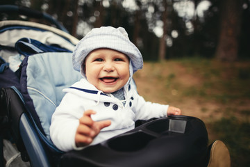 funny baby portrait in baby carriage