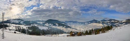 Panorama -haystack on the top of snow mountain and cloudy blue s