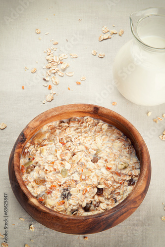 Muesli granola with raisin in wooden bowl