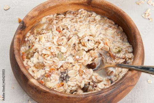 Muesli granola with fruits in wooden bowl