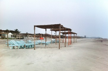 sun tents and beds at the empty beach