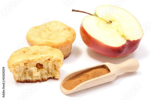 Baked muffins, fresh apple and powdery cinnamon