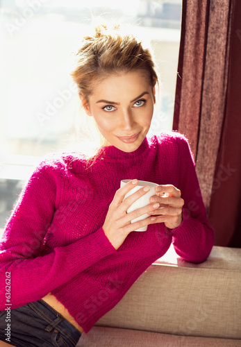 Attractive blond woman drinking a coffee
