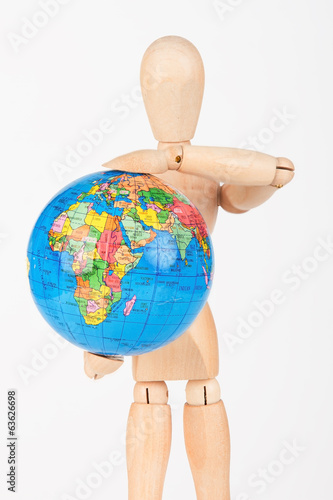 Brown wood mannequin holding concerned a globe protect