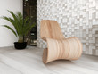 Wooden lounge chair against mosaic wall with houseplant