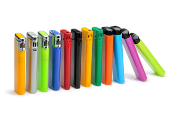 Colorful lighters on white background