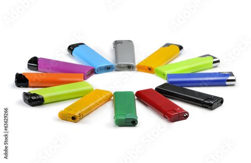 Colored lighters lie in a circle isolated on white background