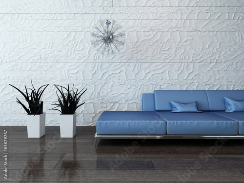canvas print picture ..Blue couch against stone wall